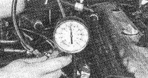 3.6 A compression gauge with a threaded fitting for the spark plug hole is preferred over the type that requires hand pressure to maintain the seal