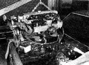5.24b . . . then lift the engine high enough to clear the body